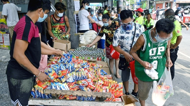 Community-run stalls offer free food to Filipinos struggling to feed their families as virus lockdowns have thrown thousands out of work. AFP